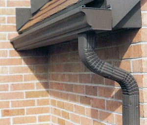 Installing gutters and downspouts