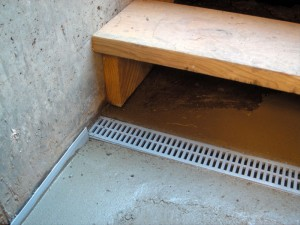 Basement entrance trench drains