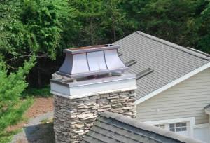Repareren van metalen schoorsteenkappen