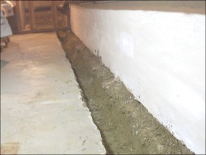 Building basement cement French drain
